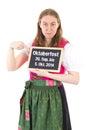 Girl in dirndl shows period of oktoberfest on chalkboard Stock Photos