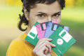 Girl with diskettes beautiful woman in yellow sweater closes person multi coloured Stock Image