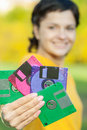Girl with diskettes beautiful woman in yellow sweater closes person multi coloured Stock Photography