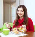 Girl divided lunch to lose weight smiling for two parts Royalty Free Stock Images