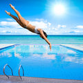 Girl diving into pool Royalty Free Stock Photo