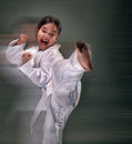 Girl do taekwondo kick practising in studio Stock Photography
