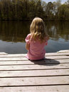 Girl on dock Royalty Free Stock Photos