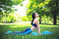 Girl does stretching outdoors