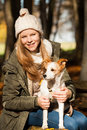 Girl with dog in autumn landscape Stock Images