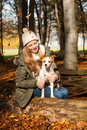 Girl with dog in autumn landscape Stock Image