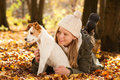 Girl with dog in autumn landscape Royalty Free Stock Images