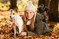 Girl with dog in autumn landscape Stock Photo