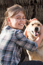 Girl with dog candid young holding stray positive feeling Royalty Free Stock Photos