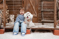 Girl with a dog on the front porch little white sunny winter day Royalty Free Stock Photography