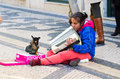 Girl with dog lisbon portugal december a gypsy plays accordion his asking for money from passersby Stock Photos