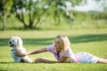 Girl and dog lying on the grass Royalty Free Stock Images