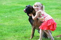 Girl with dog playing on grass Stock Photo