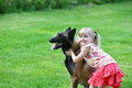 Girl with dog playing on grass Royalty Free Stock Image