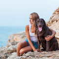 Girl and dog portrait of a woman with her beautiful sitting outdoors Royalty Free Stock Photo