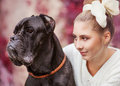 Girl and dog portrait of a young hugging a big cane corso Stock Images