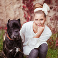 Girl and dog portrait of a young hugging a big cane corso Royalty Free Stock Photography