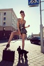 Girl and dog sensual woman standing on street outdoors Stock Photos