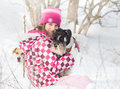 Girl with dogs hugs her dog on snow during winter walk in nature Royalty Free Stock Image