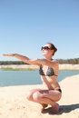 Girl doing aerobics on the beach Stock Images
