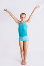 Girl doing gymast salute tween standing on white backdrop a full body gymnastics Royalty Free Stock Photos