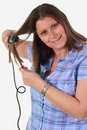 Girl doing hairstyle with hair iron Royalty Free Stock Photo