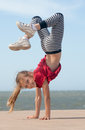 Girl doing handstand happy little by the ocean Royalty Free Stock Images