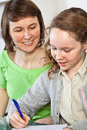 Girl doing homework with her mom Royalty Free Stock Photography