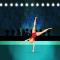 Girl doing Rhythmic Gymnastics on shiny stadium Royalty Free Stock Photo