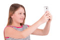 Girl doing selfie phone on white background Royalty Free Stock Photo