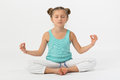 Girl doing is sitting with eyes closed in the lotus position Royalty Free Stock Image