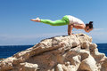 Girl doing yoga on the beach a Royalty Free Stock Photo
