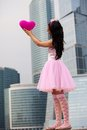 Girl doll in Big City Stock Image
