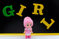 Girl doll the and english letters Royalty Free Stock Images