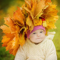 Girl with down syndrome wore a wreath of spring leaves Royalty Free Stock Photography