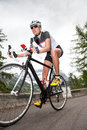 Girl downhill road cycling Royalty Free Stock Photo