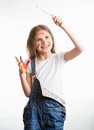 Girl drawing in the air with paintbrush over white background Royalty Free Stock Photo