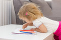 Girl drawing with colored pencils little colorful crayons at home Royalty Free Stock Photography