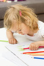 Girl drawing with colored pencils little colorful crayons at home Stock Photo