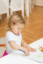 Girl drawing with colored pencils little colorful crayons at home Stock Image