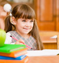 Girl drawing in copybook in classroom Royalty Free Stock Photo
