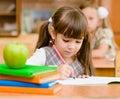 Girl drawing in copybook in classroom classroomÑŽ Stock Photos