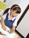 Girl drawing with crayons little Stock Photo