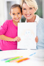 Girl drawing grandma cute little showing picture of her Royalty Free Stock Photography
