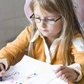 Girl drawing at home Royalty Free Stock Photo