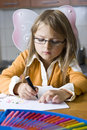 Girl drawing picture with pen Stock Photos