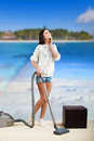 Girl dreaming of a beach vacation pretty doing housework and Royalty Free Stock Photos