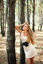 Girl dreaming in pine wood Royalty Free Stock Images