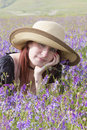 Girl dreaming in violet flowers young attractive Royalty Free Stock Photography