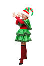 Girl in a dress of the Christmas elf shows teasing Royalty Free Stock Images